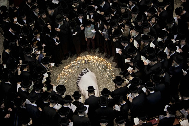 Ultra Orthodox Jews gather around the  body of Rabbi Moshe Yehoshua Hager, leader of the ~Hassidic sect Vizhnitz in Israel,at the Vizhnitz Synagogue during his funeral procession in Bnei Brak , Ultra Orthodox Jewish town near Tel Aviv, Israel, Wednesday, March 14, 2012. Rabbi Moshe Yehoshua Hager was 95.(AP Photo/Oded Balilty)