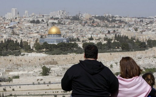 Gov. Chris Christie and first lady Mary Pat Christie look out over Jerusalem on the Mount of Olives in Jerusalem, Israel on Monday, April 2, 2012. (Governor's Office/Tim Larsen)