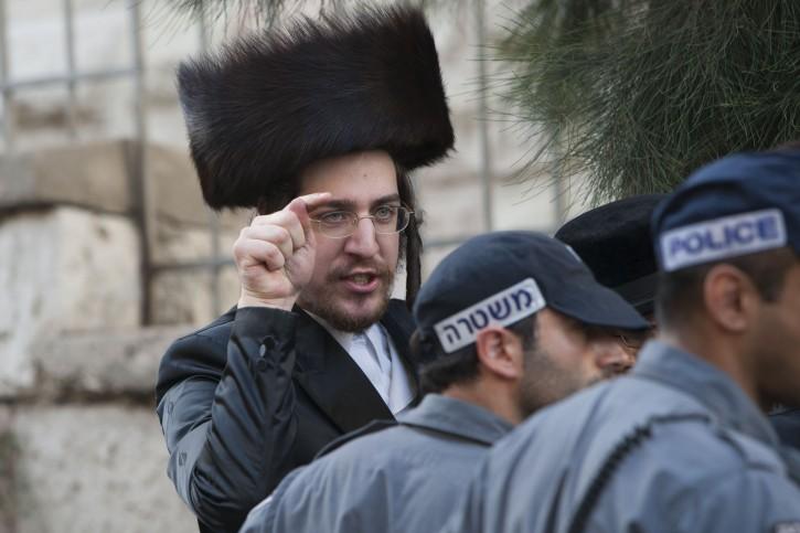 Ultra Orthodox Jewish men residents from Meah Shearim neighborhood in Jerusalem clashes with Israeli police in Hanivim street in Jerusalem. June 16, 2012. Photo by Yonatan Sindel/Flash 90