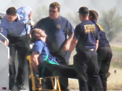 FILE - JetBlue captain Clayton Osbon being tended to by emergency workers (AP Photo/Steve Douglas)