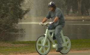 Izhar Gafni riding the cardboard bike