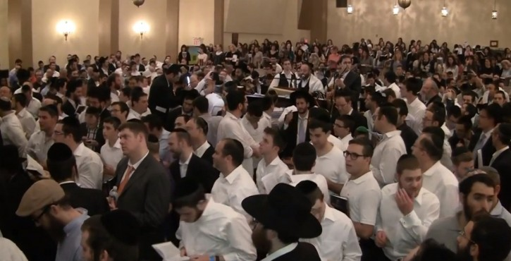An image grab from video: Popular singer Yehuda Green served as the baal tefila for last night's Selichos held at the Carlebach Shul on West 76th Street on Sept. 9 2012
