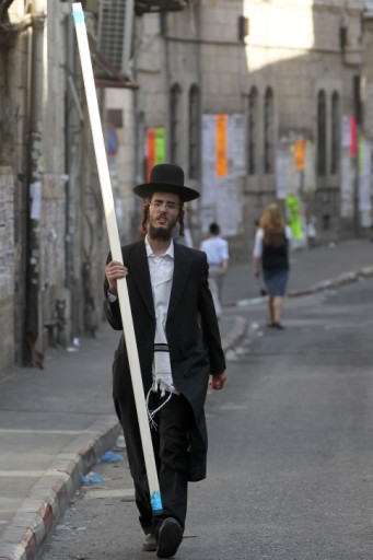 An ultra orthadox Jewish man carrying wood to build a sukkah in the ultra orthadox neighborhood of Mea Sherim. Photo by Nati Shohat/Flash90.