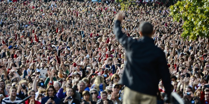President Barack Obama waves after addressing a large crowd at a campaign event at the University of Wisconsin in Madison, Wisconsin, USA 04 October 2012. Obama returned to the campaign trail following his debate on 03 October with Republican Presidential Candidate Mitt Romney. EPA/TANNEN MAURY