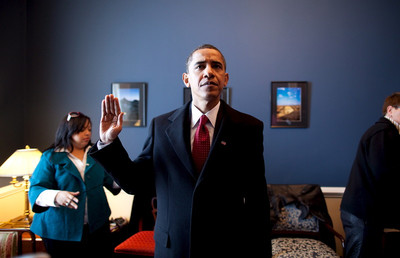 FILE -  In this handout photo made available by the White House on 24 January 2009 US President-elect Obama practices how he will hold his hand during the swearing in at the U.S. Capitol in Washington D.C., USA, 20 January 2009.  EPA/PETE SOUZA /