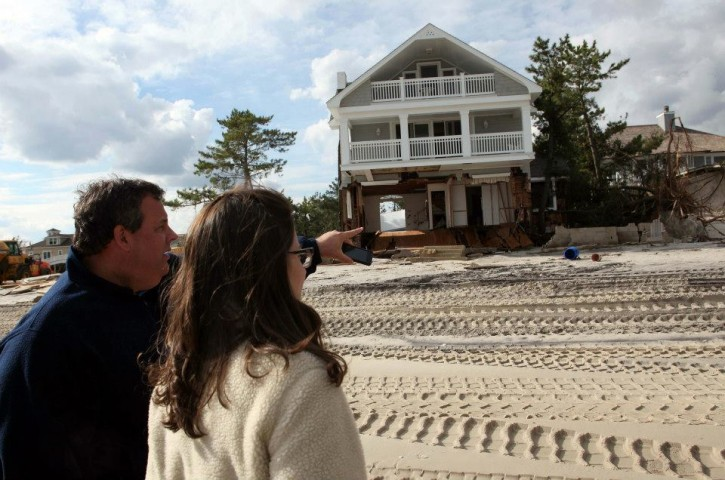 FILE - Governor Chris Christie and Deputy Chief of Staff for Communications Maria Comella survey the Hurricane Sandy damaged areas between the ocean and Rt 35 in Bayhead, N.J. on Friday, Nov. 2, 2012. (Governor's Office/Tim Larsen)