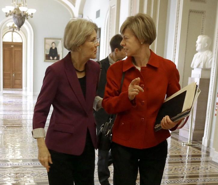 This Nov. 13, 2012 file photo shows Sen-elect Elizabeth Warren, D-Mass., left, and Sen-elect, current Rep. Tammy Baldwin, D-Wis. walking together on Capitol Hill in Washington. (AP Photo/Pablo Martinez Monsivais, File)