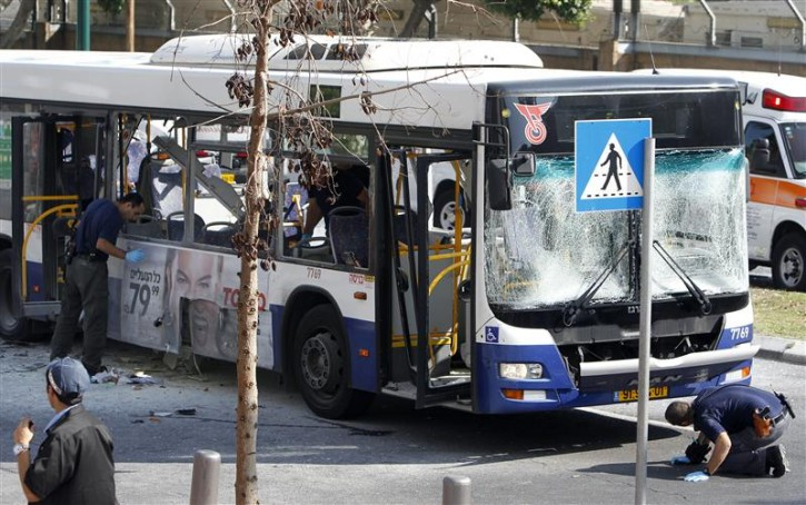 Israeli police survey the scene after an explosion on a bus in Tel Aviv November 21, 2012. An explosion hit a bus in the heart of Tel Aviv on Wednesday, wounding at least 10 people in what officials said was a terrorist attack. REUTERS/Nir Elias