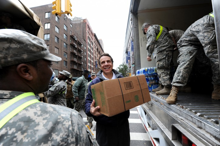 New York Governor Andrew Cuomo (C) helps National Guard troopers load food and water onto trucks to distribute to those in need, as the city tries to recover from the after effects of Hurricane Sandy in New York, New York, USA, 01 November 2012.  EPA/ANDREW GOMBERT