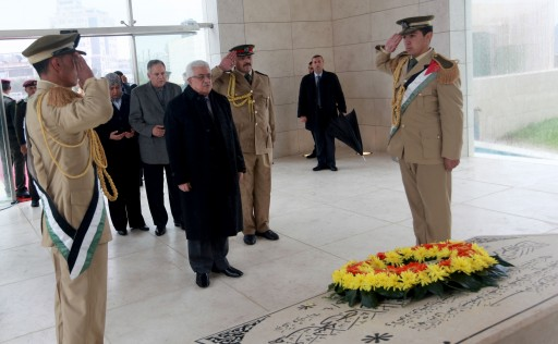 FILE - Palestinian President Mahmoud Abbas (C) lays a wreath at the grave of late Palestinian leader Yasser Arafat prior to the official ceremony of marking the eighth anniversary of his death, in the West Bank city of Ramallah, 11 November 2012.  EPA/Fadi Arouri  / POOL