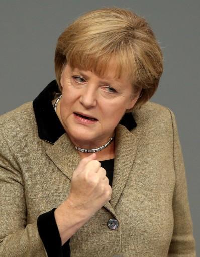 German Chancellor Angela Merkel addresses the lower house of German parliament in Berlin, 21 November 2012.  EPA