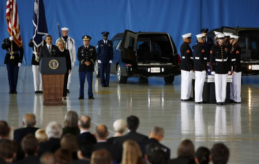 U.S. President Barack Obama and Secretary of State Hillary Clinton participate in a transfer ceremony of the remains of U.S. Ambassador to Libya, Chris Stevens and three other Americans killed this week in Benghazi, at Andrews Air Force Base near Washington, September 14, 2012. REUTERS/Jason Reed