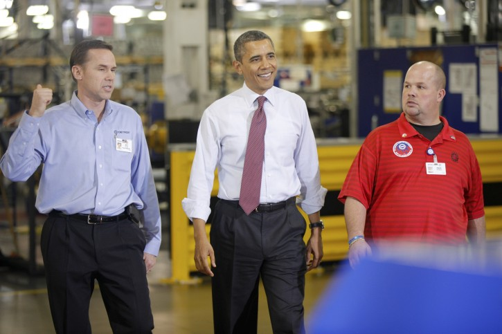President Barack Obama walks with Plant Manager and Vice President of Operations Jeff Allen, left, and UAW NW Local 163 Detroit Diesel Engine Unit Shop Chairperson Mark