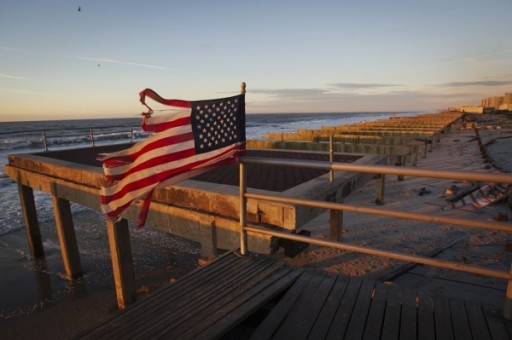 n American flag stands on top of the devastated Rockaway beach boardwalk due to the effects of Hurricane Sandy in the Queens borough of New York.(Photo : Reuters)
