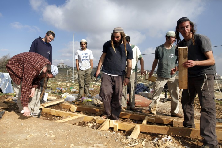 Israeli Jewish settlers disassemble the illegal west bank outpost of Oz Zion, December 30, 2012. Security forces in Oz Zion evacuated a small group of young settlers who remained in the illegal West Bank outpost after dark last night. No clashes were reported. Photo by FLASH90