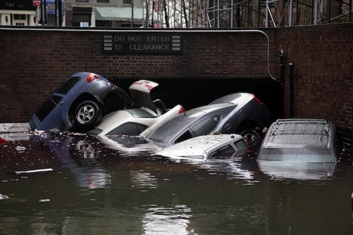 Cars are submerged at the entrance to a parking garage in New York's Financial District in the aftermath of superstorm Sandy.<br /> The Associated Press/Richard Drew