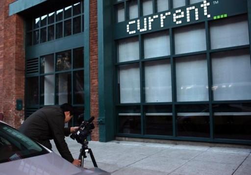 A journalist captures video of Current TV in San Francisco, California January 3, 2013. REUTERS/Robert Galbraith