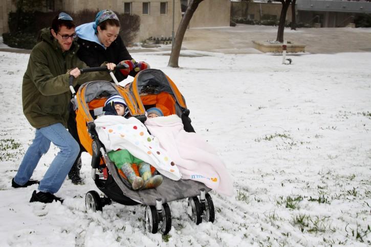 Israelis play in the snow at Kibbutz Migdal Oz, in Gush Etzion, near Jerusalem, January 09, 2013. Photo by Gershon Elinson/Flash90