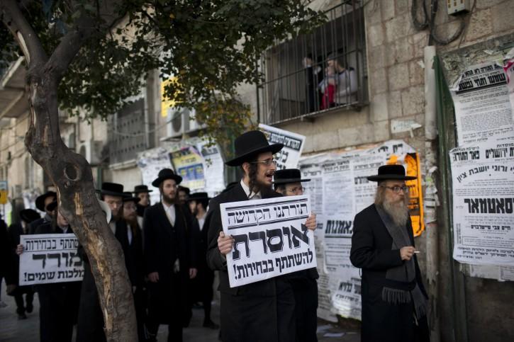 An Ultra orthodox jews, belonging to Natorei Karta holds up a sign against the Israeli elections in the ultra orthodox neighborhood of mea shearim, Jerusalem, January 22, 2013. Photo by Yonatan Sindel/Flash90