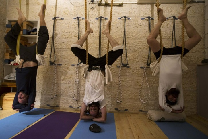 Ultra-Orthodox Jewish men take part in a yoga class at a studio in Ramat Beit Shemesh, about 12 miles from Jerusalem. Almost a dozen devout Jewish men meet weekly at the studio, the only one of its kind in the area. (Ronen Zvulun/Reuters)
