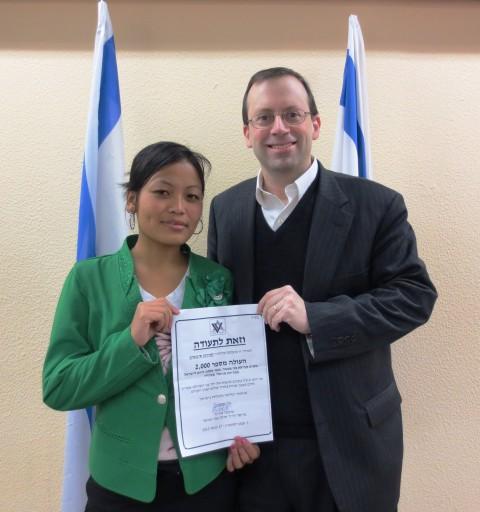 Shavei Israel Chairman Michael Freund with Mirna Singsit the 2000th Bnei Menashe immigrant Jan 17 2013