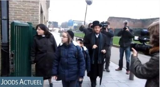 Rabbi Moshe Aryeh Friedman arriving at school with his children on Jan. 7 2013. Photo: Joods Actueel
