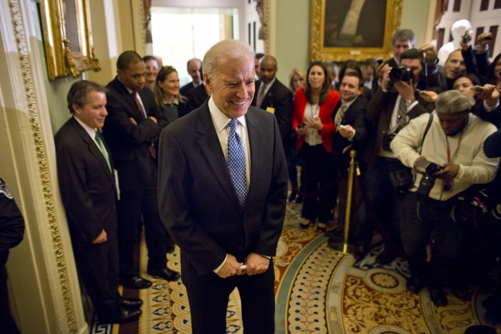 US Vice President Joe Biden (C) speaks briefly with the media as he leaves a Democratic caucus to negotiate a fix to the so-called fiscal cliff in Washington, DC, USA, 31 December 2012. The Senate may still vote tonight on legislation, with the House following in the next few days.  EPA/JIM LO SCALZO