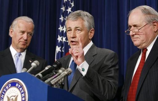 File photo of Former U.S. Sen. Chuck Hagel, R-Neb., center, flanked by Vice President Joe Biden and Sen. Carl Levin, D-Mich.<br /> (Photo: Reuters)