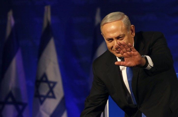 Israel's Prime Minister Benjamin Netanyahu waves to supporters upon arrival at the Likud party headquarters in Tel Aviv January 23, 2013. Hawkish Prime Minister Benjamin Netanyahu emerged the bruised winner of Israel's election on Tuesday, claiming victory despite unexpected losses to resurgent centre-left challengers. REUTERS/Baz Ratner