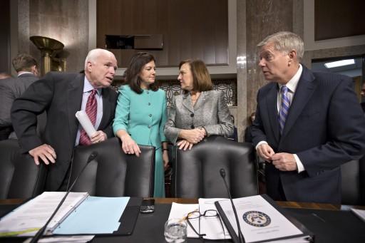 FILE – In this Feb. 12, 2013 file photo Senate Armed Services Committee members, from left, Sen. John McCain, R-Ariz., Sen. Kelly Ayotte, R-N.H., Sen. Deb Fischer, R-Neb., and Sen. Lindsey Graham, R-S.C., gather for a Capitol Hill hearing on former Nebraska Sen. Chuck Hagel's nomination to Secretary of Defense. (AP Photo/J. Scott Applewhite, File)