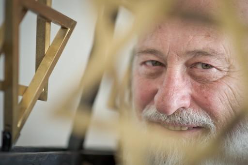 FILE -  Rabbi David Goldberg looks through a golden Star of David in a room of the Israeli religious community in Hof, Germany, 26 July 2012. EPA