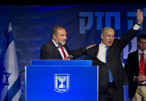 Israeli Prime Minister Benjamin Netanyahu (R ) and Avigdor Lieberman after Netanyahu's speech in Tel Aviv, early 23 January 2013. EPA/JIM HOLLANDER