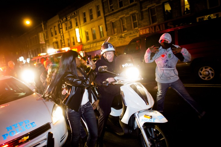 Demonstrators march through the streets alongside police officers during a march following a vigil held for Kimani Kiki Gray in the East Flatbush neighborhood of Brooklyn, Wednesday, March 13, 2013. (AP Photo/John Minchillo)