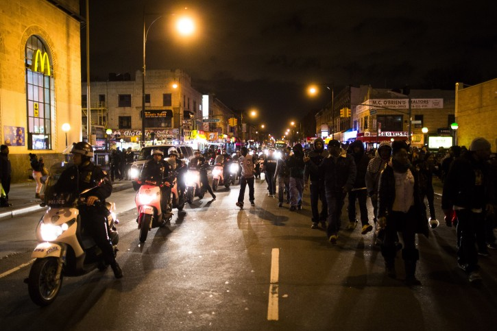 Demonstrators march through the streets alongside police officers following a vigil held for Kimani Kiki Gray in the East Flatbush neighborhood of Brooklyn, Wednesday, March 13, 2013. (AP Photo/John Minchillo)