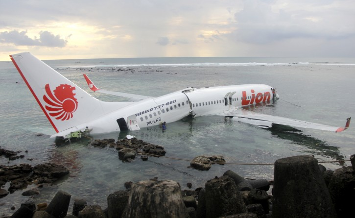 Wreckage a crashed of Lion Air Plane seen on the water off Ngurah Rai international airport, Kuta, Bali, Indonesia on Saturday, April 13, 2013. Lion Air plane carrying more than 100 passengers and crew overshot a runway on the Indonesian resort island of Bali on Saturday and crashed into the sea, injuring nearly two dozen people, officials said. (AP Photo/Handout Indonesian Police)