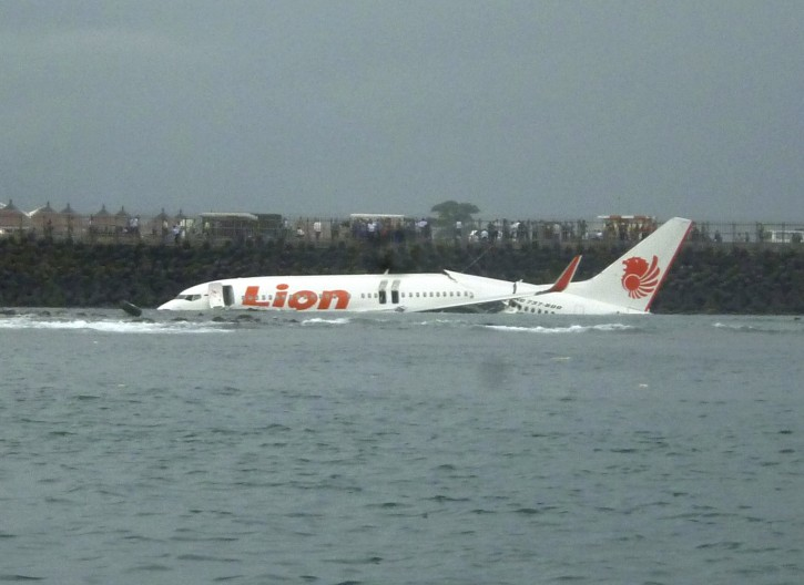 Wreckage a crashed of Lion Air Plane seen on the water off Ngurah Rai international airport, Kuta Bali, Indonesia on Saturday, April 13, 2013. Lion Air plane carrying more than 100 passengers and crew overshot a runway on the Indonesian resort island of Bali on Saturday and crashed into the sea, injuring nearly two dozen people, officials said. (AP Photo/STR)
