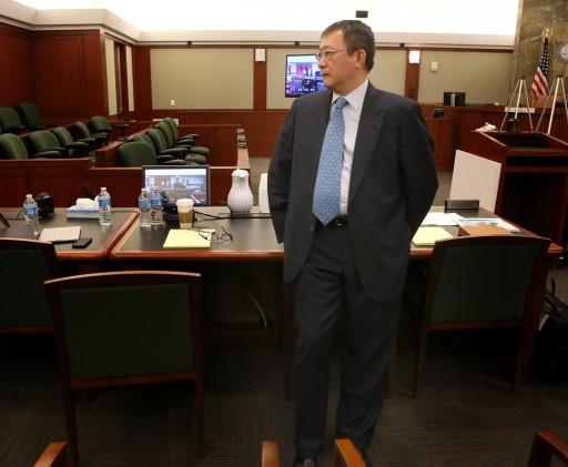 Hong Kong businessman Richard Suen stands in the courtroom before the beginning opening statements in Suen's lawsuit against Las Vegas Sands, Wednesday, April 3, 2013 in Clark County Regional Justice Court in Las Vegas. (AP Photo/Las Vegas Review-Journal, Jeff Scheid)