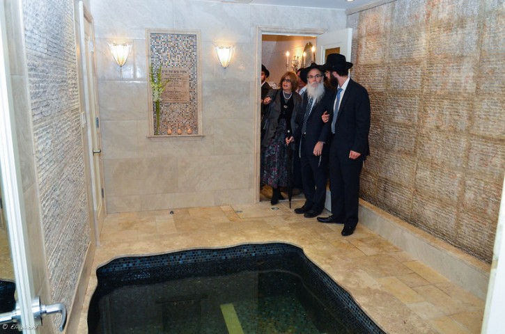 Attendees of the grand-opening ceremony on a walk-through tour of the recently completed Park Slope mikvah. April 29 2013. Photo Eli Wohl