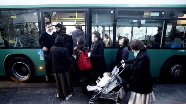Orthodox women enter a gender-segregated bus through the back door (photo credit: Uri Lenz/Flash90)