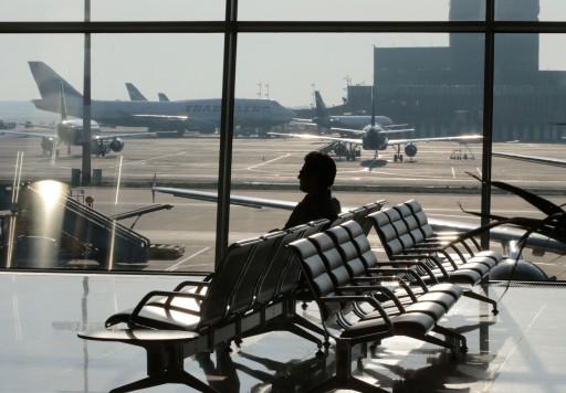 FILE - A passenger waits for his flight at Moscow's Sheremetyevo airport June 26, 2013. REUTERS/Tatyana Makeyeva
