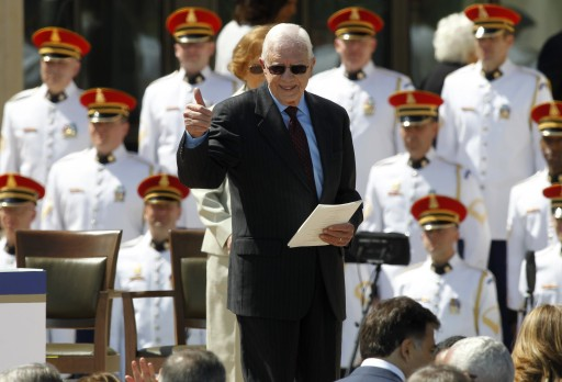 Former U.S. President Jimmy Carter leaves the stage at the end of the dedication of the George W. Bush Presidential Center on the campus of Southern Methodist University in Dallas, Texas April 25, 2013. REUTERS/Mike Stone