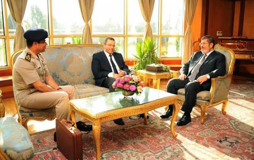 In this file photo Monday, July 1, 2013, Egyptian President Mohammed Morsi, right, meets with Prime Minister Hesham Kandil, center, and Egyptian Minister of Defense, Lt. Gen. Abdel-Fattah el-Sissi, left in Cairo, Egypt. (AP Photo/Egyptian Presidency, File)