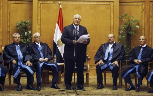 Adli Mansour (C), Egypt's chief justice and head of the Supreme Constitutional Court, speaks at his swearing in ceremony as the nation's interim president in Cairo July 4, 2013, a day after the army ousted Mohamed Mursi as head of state. REUTERS/Amr Abdallah Dalsh