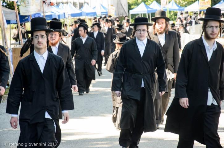 Thousands Of ultra orthodox  Jews / Hasidim Mark 34th Yartzeit Of Rabbi Joel Titlebaum Zt'l in the village of Kiryas Joel near Monroe NY on Aug 2, 2013. photos by Stefano Giovannini