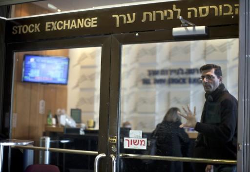 FILE: A man leaves the Tel Aviv Stock Exchange. EPA/OLIVER WEIKEN