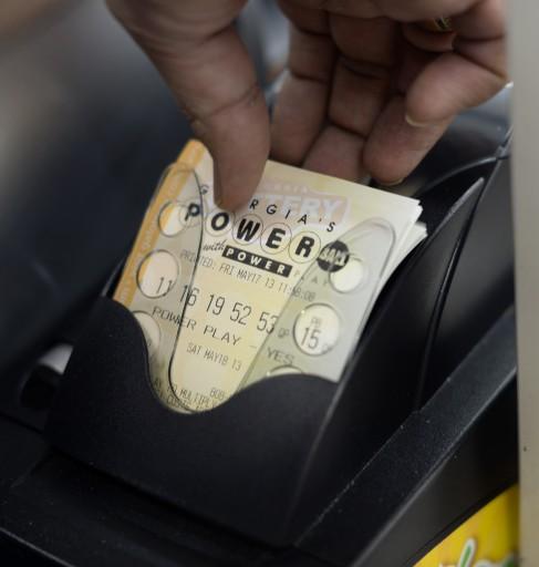 File photo of a customer purchasing Powerball tickets. EPA/ERIK S. LESSER
