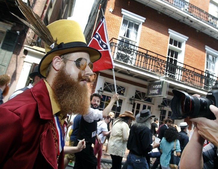 Jeffrey Moustache keeps eyes straight ahead as a photographer singles him out during a parade through the French Quarter kicking off the fourth annual Just For Men National Beard and Moustache Championships Saturday, Sept. 7, 2013 in New Orleans. Moustache was competing in the Verdi division. Contestants competed in 18 different categories including Dali, full beard natural and sideburns. (AP Photo/Susan Poag)