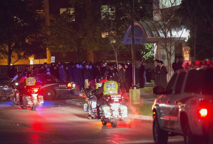 Toronto police take part as Mourners are seen outside the Funeral of Toronto real estate mogul Paul Reichmann at the Bais Yaakov Girls School in Toronto on Saturday October 26, 2013. Media photographers where prohibited of entring inside the event (Photo by Aaron Vincent Elkaim/VINnews.com)
