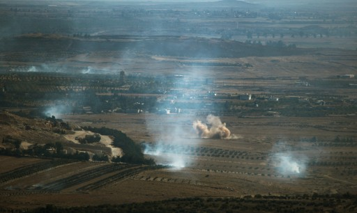 File: Smoke rising due to a fire caused by mortar fire near the village of Afania on the Syrian side of the border with Israel in the Golan Heights, on 08 October 2013. EPA/ATEF SAFADI
