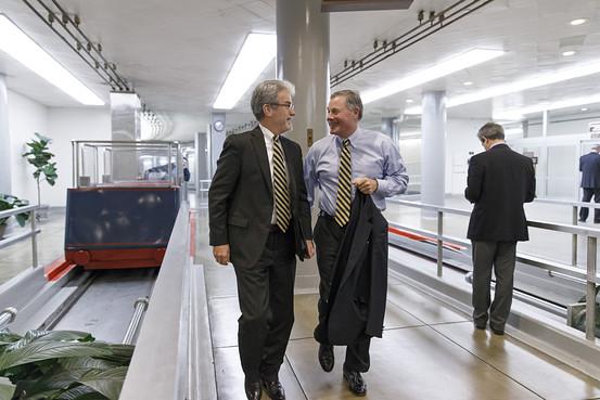 Sen. Tom Coburn (R., Okla) (Left) walks with Sen. Richard Burr (R., N ...